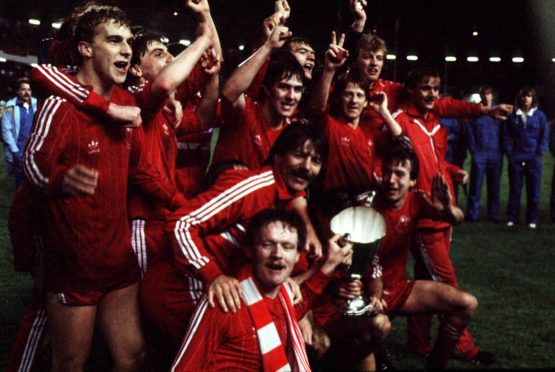 The Aberdeen team pictured with the European Cup Winners' Cup after beating Real Madrid.