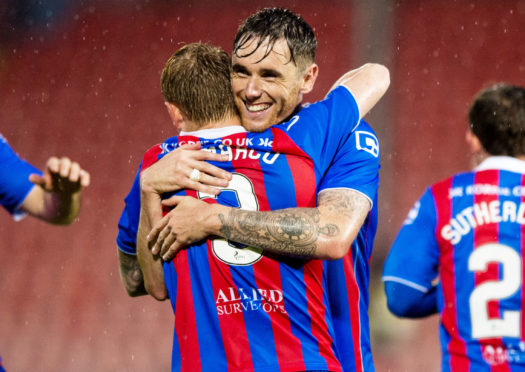 Greg Tansey celebrates with Carl Tremarco during a game against Dunfermline.