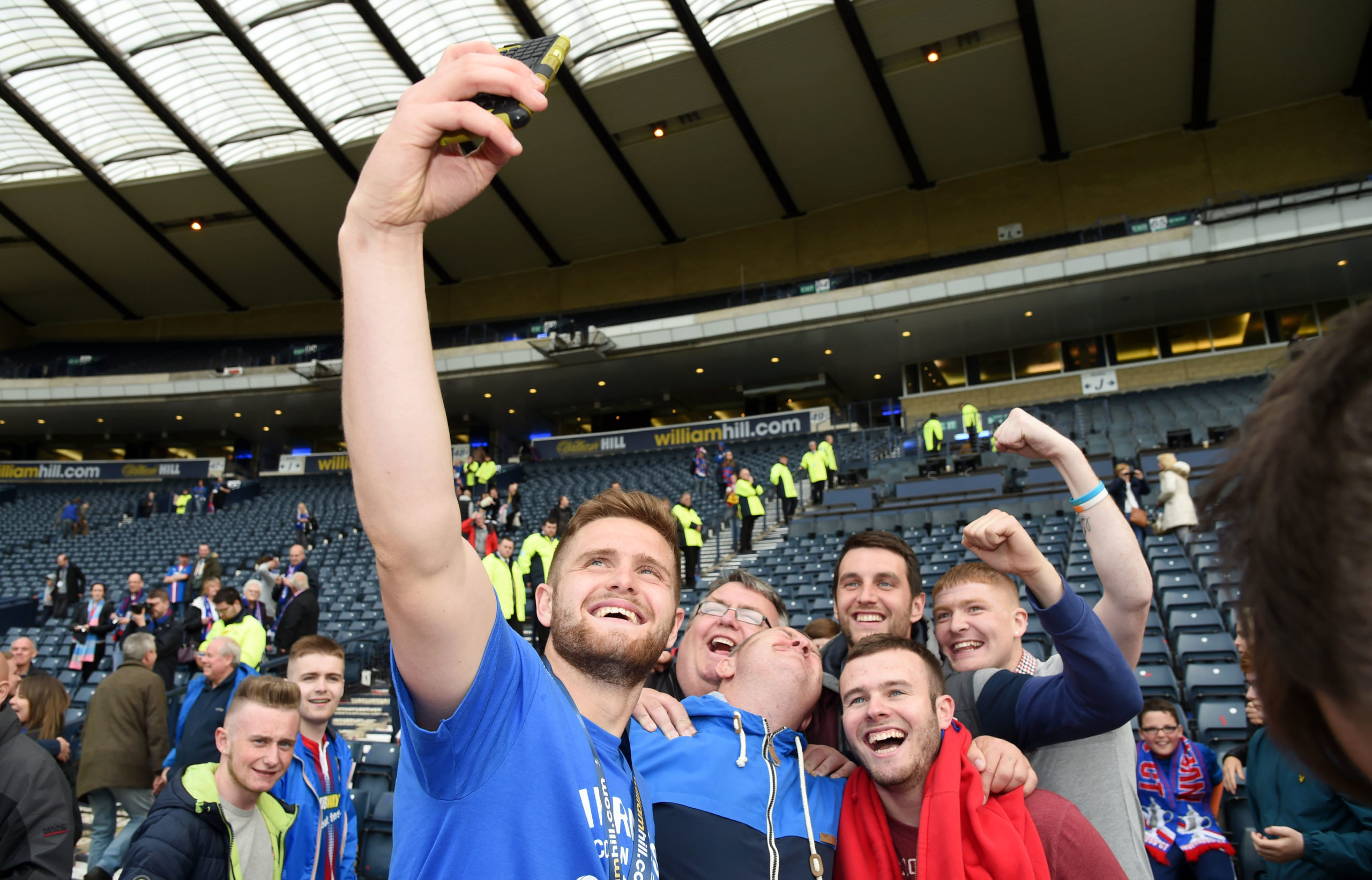 Danny Devine celebrates with the fans after winning the 2015 Scottish Cup.