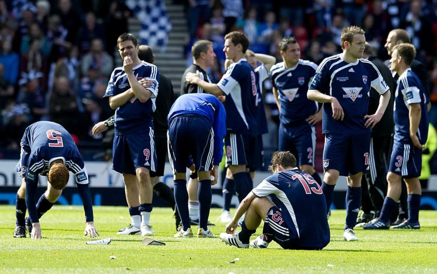 Dejection for the Ross County players at the end of the match.
