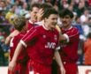 Jim Bett, front, and Robert Connor, right, after Brian Irvine scored the winning penalty.