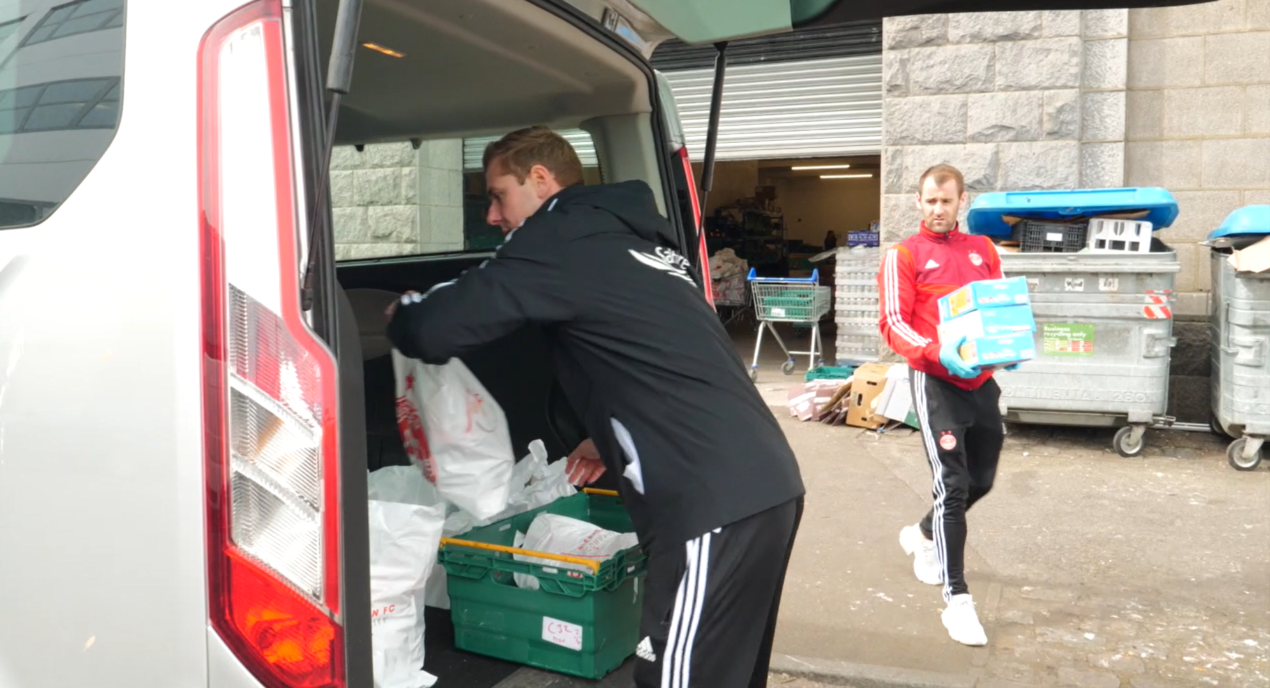 Aberdeen FC players deliver food parcels to vulnerable city residents.