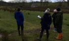 Community members visit the proposed housing site in the Hydro Field