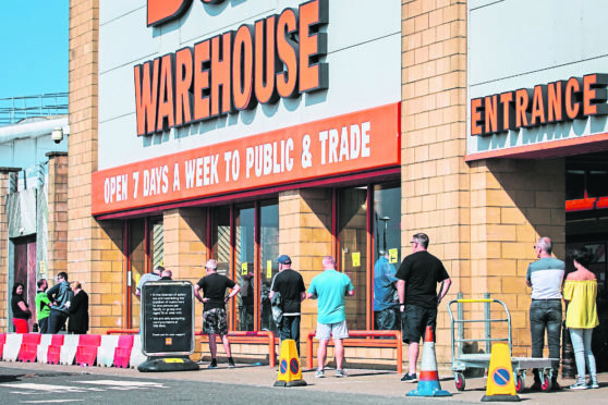 Big queues of customers queuing to get into the B&Q store in Parkhead, Glasgow.