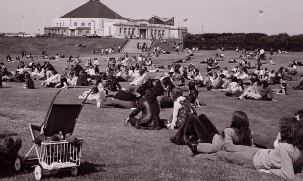All the fashions of the 70s on display at Aberdeen Beach in 1973.