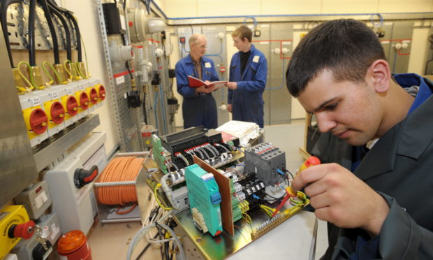 Students Bob Allan, Alex Hutchinson and Edward Padel at the Epit facility.