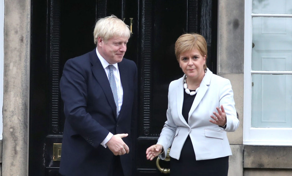 Scotland's First Minister Nicola Sturgeon welcomes Prime Minister Boris Johnson outside Bute House in Edinburgh.