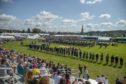 Crowds watch the massed bands at the start of the 2019 Aboyne Highland Games - credit Harry Scott (Deeside Camera Club)