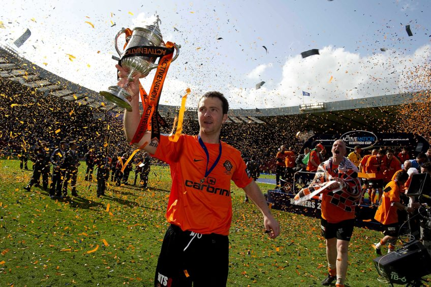 Dundee Utd captain Andy Webster with the cup.