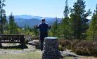 Gordon Riddler completing his challenge atop Craigendarroch