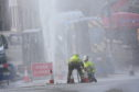 Scottish water engineers work on Williamson Street in Wick.