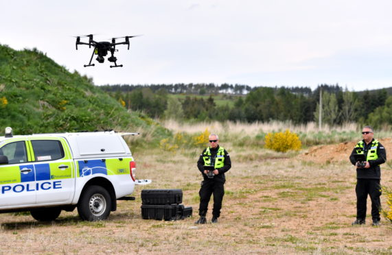 Police using a drone in the area of Feuchside, Deeside, Aberdeenshire in search for missing Robin Green.