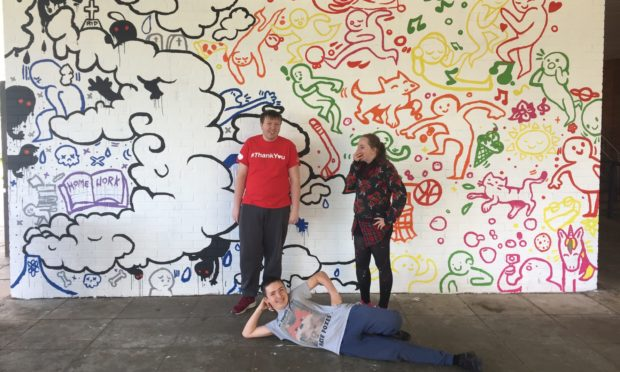 Tackling mental health: young people give back to their community.   Jake Weston, Liam Leslie and Laura MacGillivary from Charleston Academy, Inverness in front of the mural created for mental health charity Mikeysline