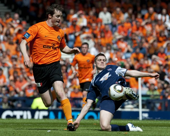 Jon Daly closes down Iain Vigurs.