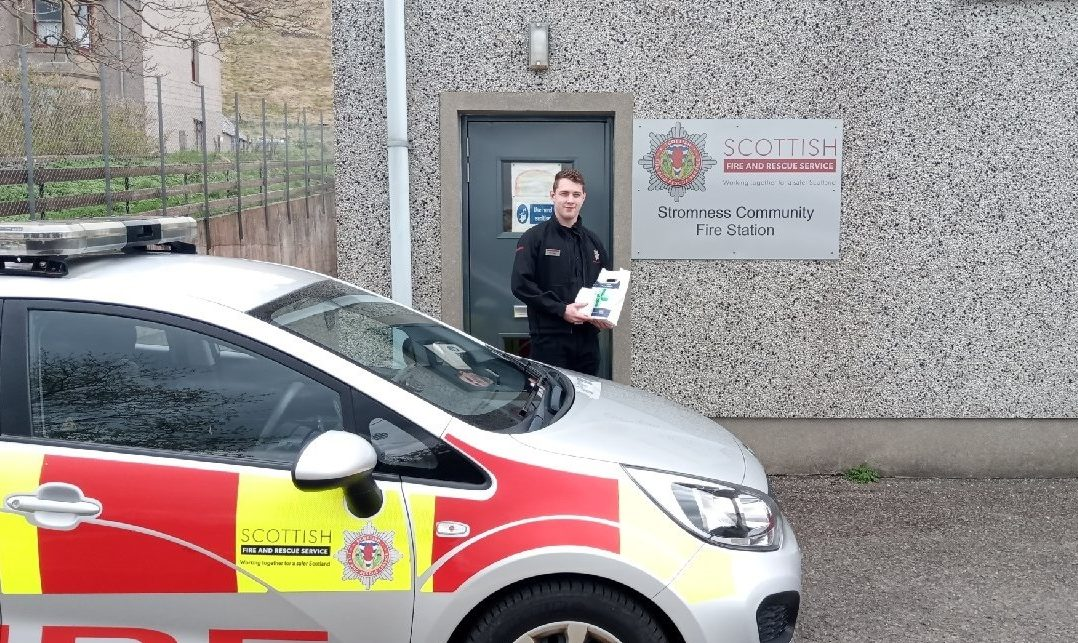 Firefighter Ross Harvey with prescriptions picked up from local chemist.