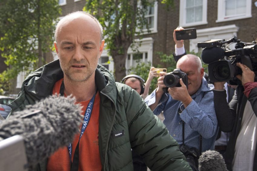 Dominic Cummings leaves his London home to discuss his future with Boris Johnson