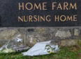Flowers laid out the front of the Home Farm Nursing Home. Picture by Iain Smith.