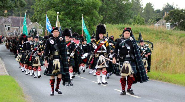 The Lonach Highlanders marching through Bellabeg.