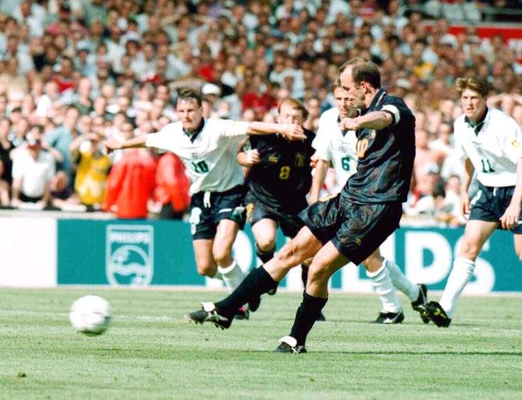 Scotland captain Gary McAllister steps up to hit a penalty but fails to score.