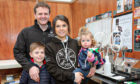 Orkney Distillery co-owners Aly and Stephen Kemp with their children.