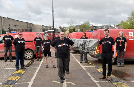 Staff at the Inverurie Royal Mail Delivery Office with their special T-shirts. Picture by Darrell Benns.