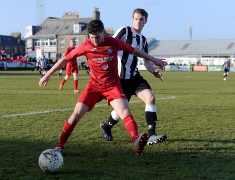 Tom Kelly (left) won the title with Brora Rangers this season