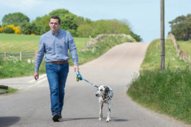 Douglas Ross walked his dog Murphy near his home after announcing his resignation.
