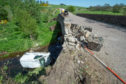 The van in the River Isla after hitting the bridge on the B9014 from Keith to Dufftown. Picture by Jason Hedges.