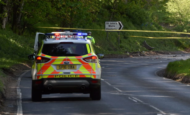 Police remain at the site of the A947 crash near Fyvie. Picture by Kenny Elrick