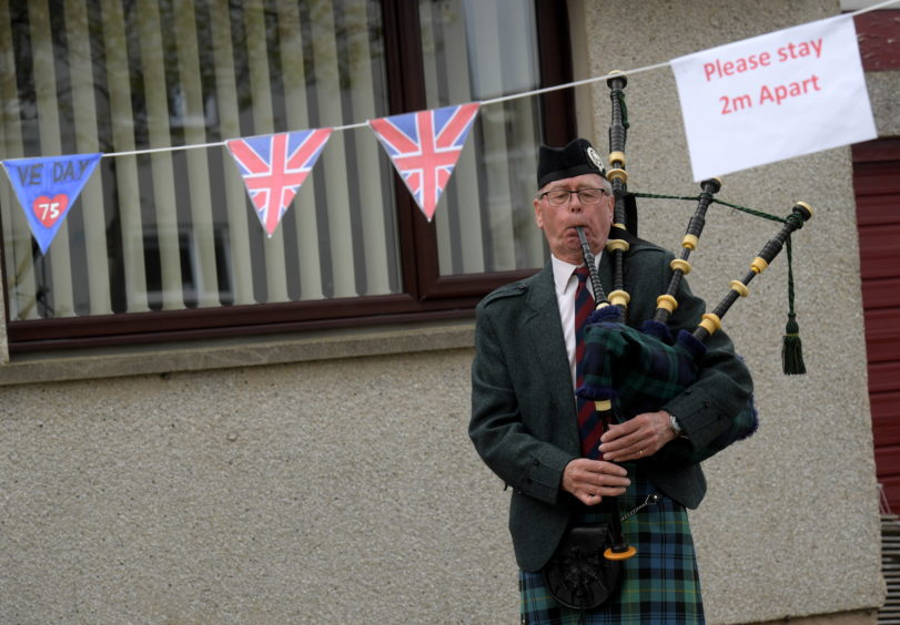 VE Day street party on Woodend Crescent, Aberdeen. Piper and former Scots Guard John Gordon. CR0021281 08/05/20 Picture by KATH FLANNERY