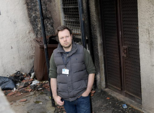 Councillor Ciaran McRae pictured alongside the damage.   Photo by Kath Flannery