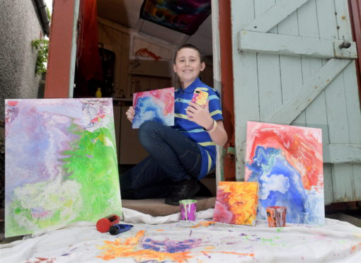 12 year old Aled Smith from Fraserburgh has been spending lockdown in his shed, painting designs onto canvasses. With the help of his mum he's hoping to print them onto products for local businesses. CR0021459 21/05/20 Picture by KATH FLANNERY