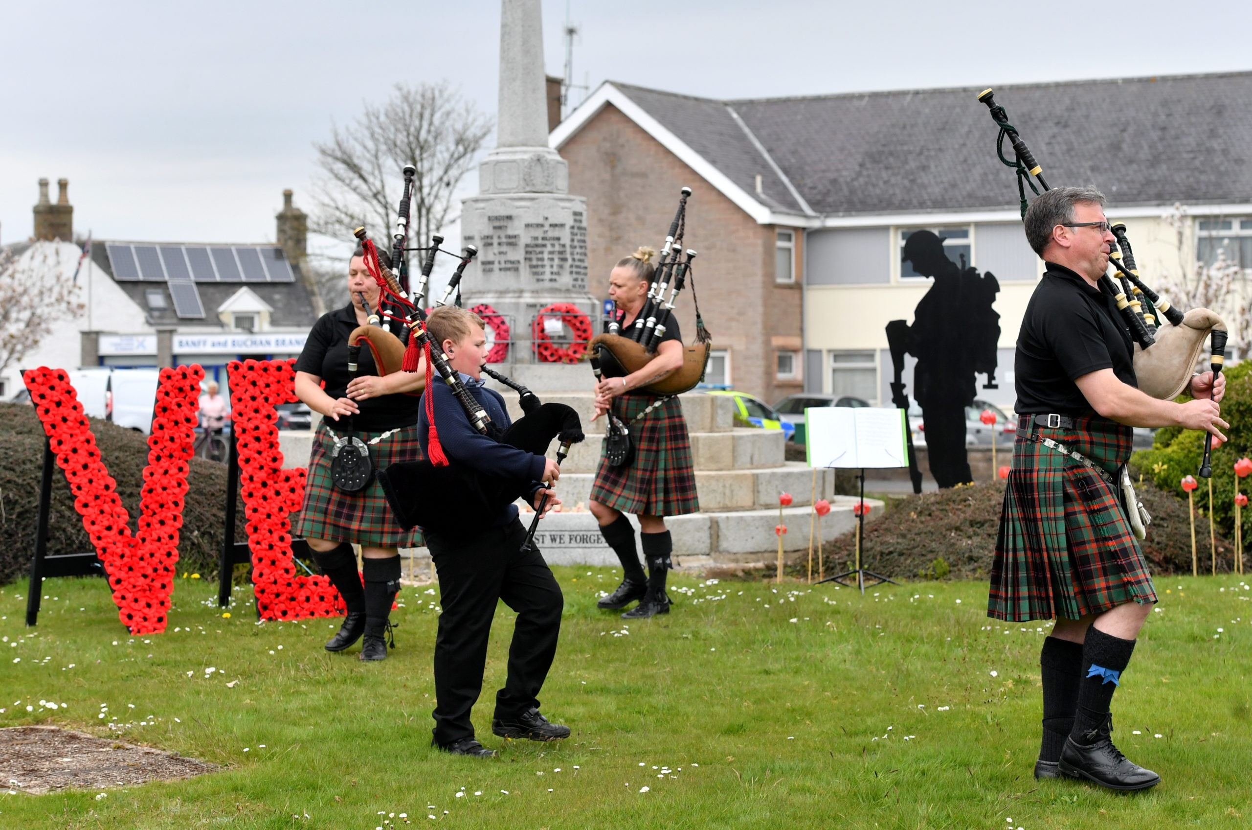 CR0021205 Pictured - Four members of the Buchan Peterson Pipe Band play at the Mintlaw war memorial for VE Day, L-R  Pamela Whyte, Kyle Elrick, Mandy Rae and Malcolm Whyte.     Picture by Kami Thomson         08-05-2020