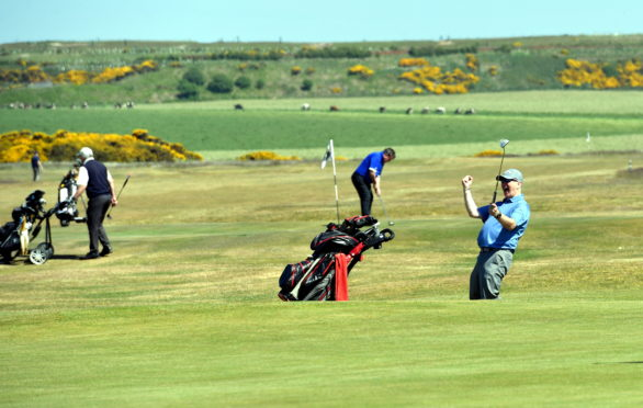 One golfer celebrates as Murcar Links Golf Club reopens thanks to the easing of restrictions.    Picture by Kami Thomson