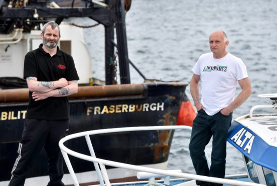 Fisherman Michael Ritchie (left) and Robert Souter (right) at Fraserburgh Harbour.  Picture by Scott Baxter