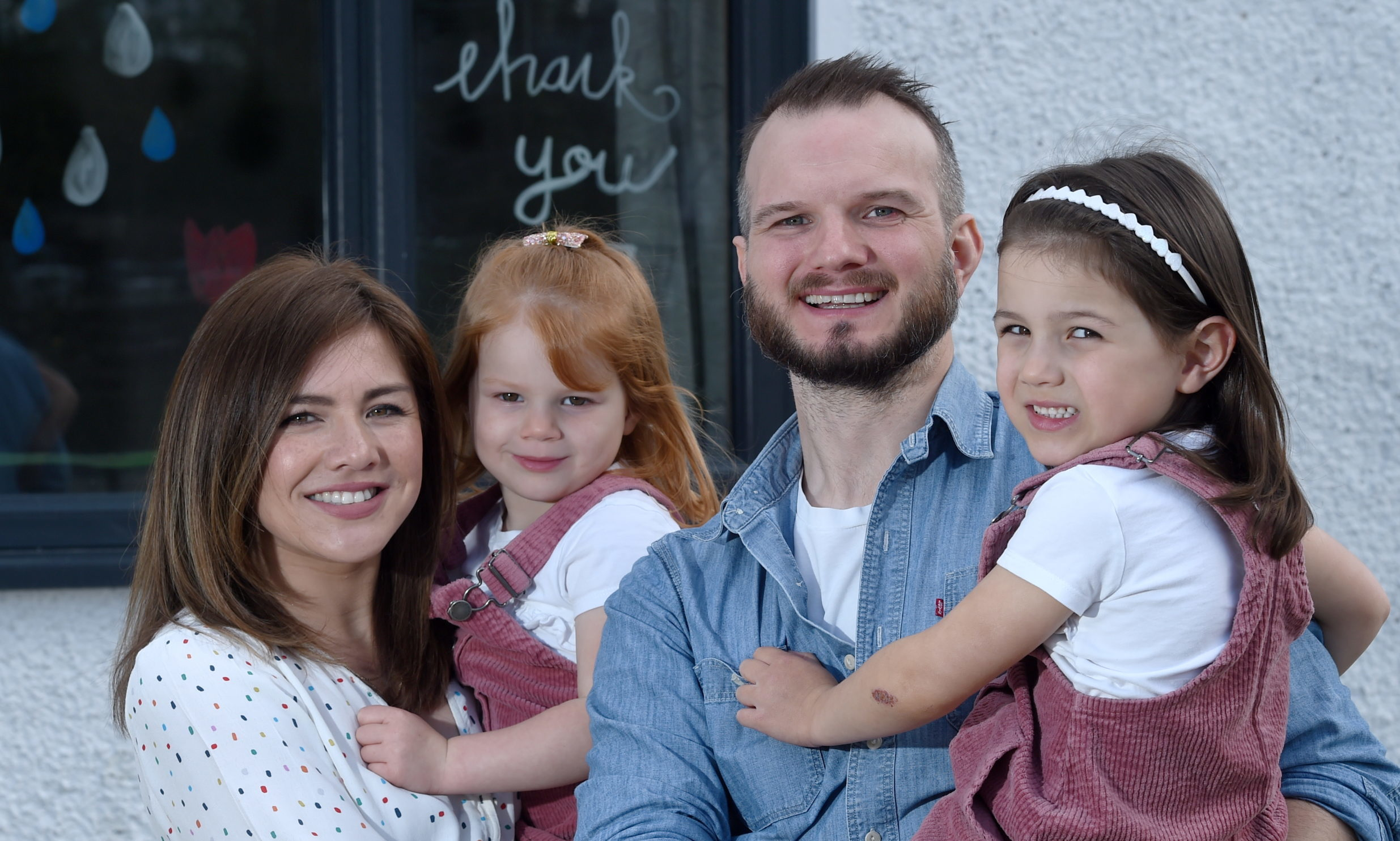 Former cancer patient, David Kennedy with his wife Mae and daughters Harriet (3) and Lotte (6). Picture by Sandy McCook