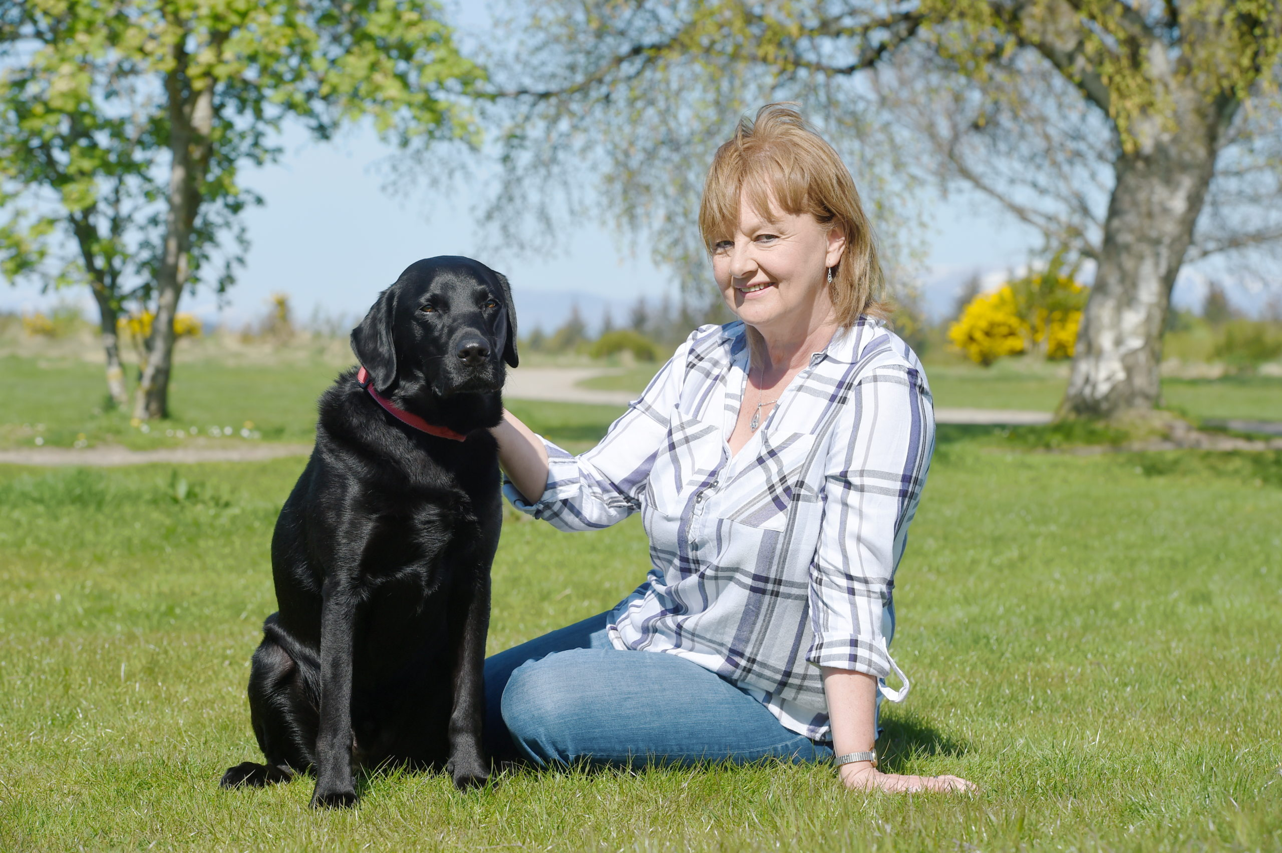 Eleanor Dexter with her own dog 'Boris' at Culloden.
