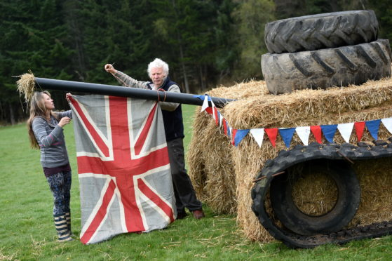 Sylvia McFarlane and John Kirk put the finishing touches to a bale art tank in Nethy Bridge. Picture by Sandy McCook