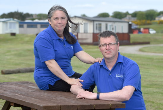 Lynn and Darren Redfern of Dornoch Caravan and Camping Park are calling for more clarity and support to allow safe reopening. Picture by Sandy McCook