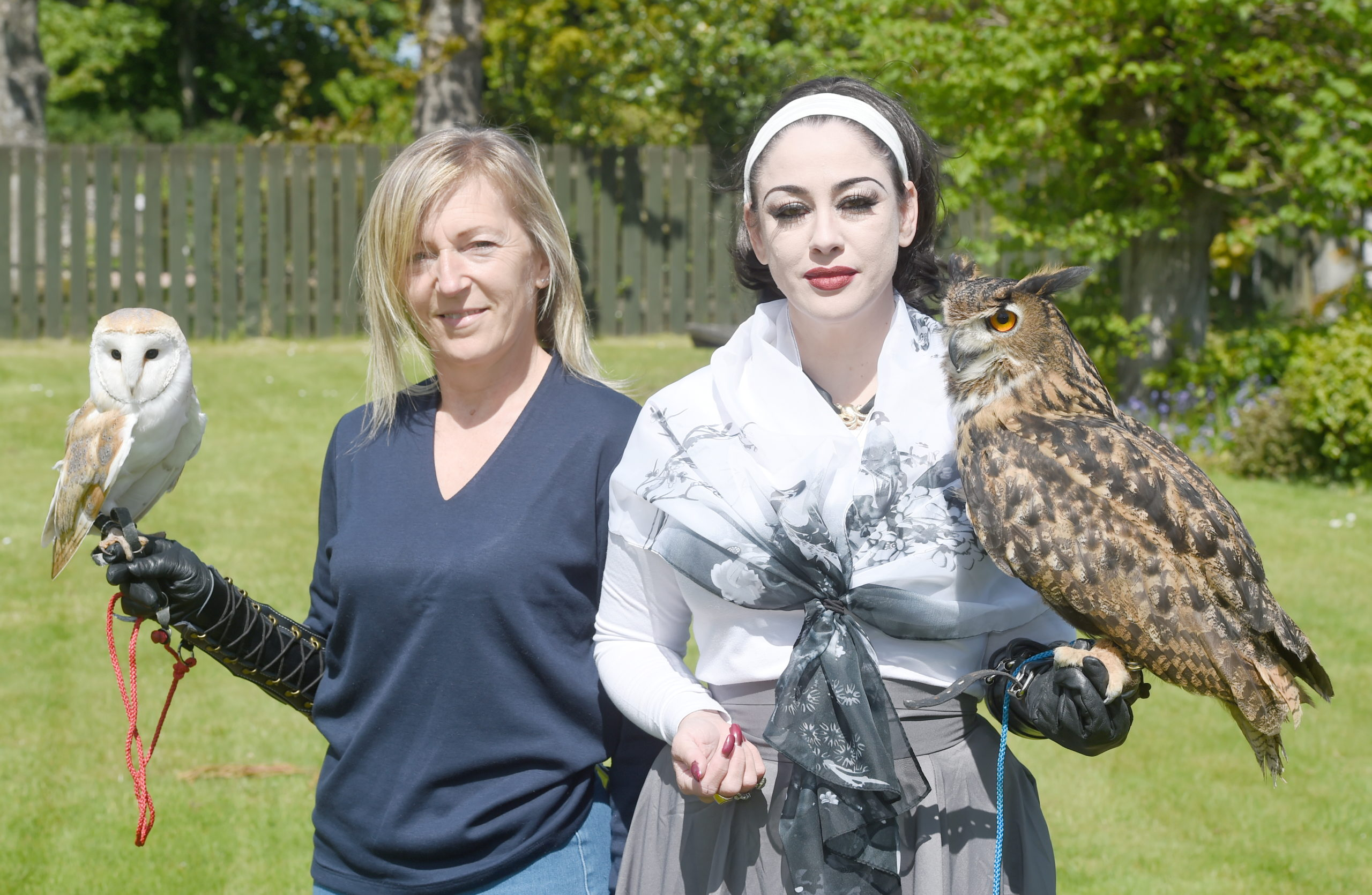 Jane Wilson and Hadassah Broscova-Righletti of the Blue Highlands Bird of Prey Rescue Centre in Brora with 'Bella' the barn owl and 'Cherlock' a Eurasian Eagle Owl. Picture by Sandy McCook.
