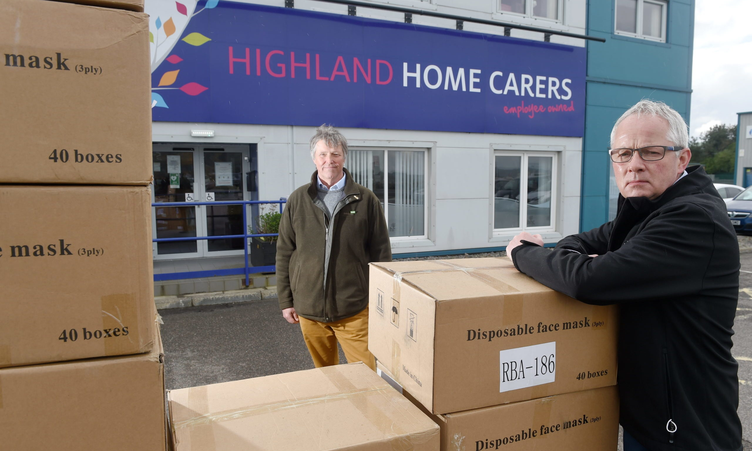 Edward Mountain and Campbell Mair of Highland Home Carers with some of the masks. Picture by Sandy McCook