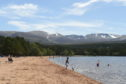 People enjoy the warm weather at Loch Morlich following the ease of lockdown measures. Picture by Sandy McCook.