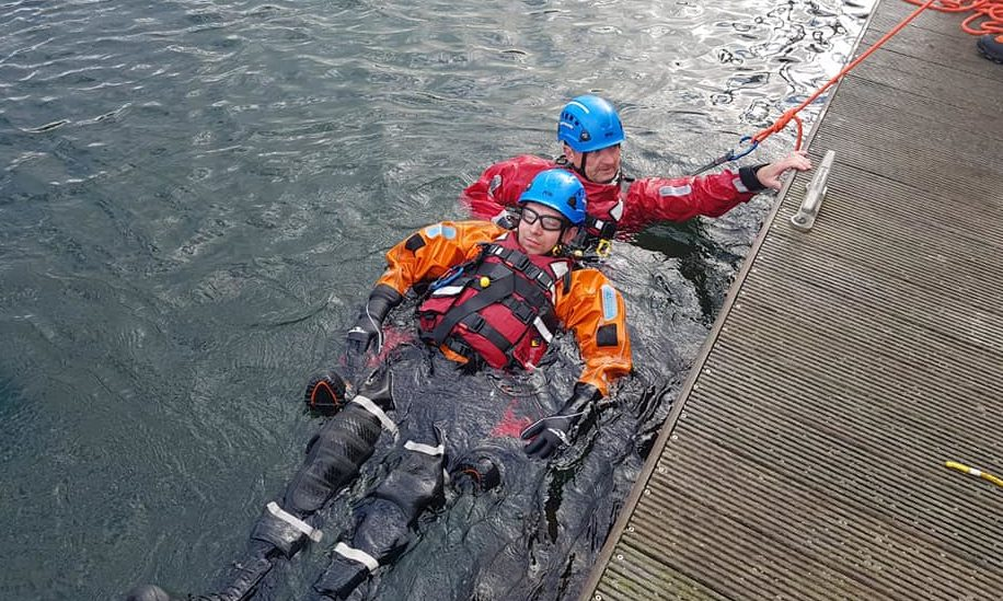 Photos of a rescue swimmer during training.