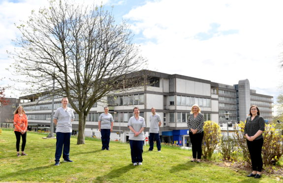 RGU's Heather Bain, nurses Michael Solo, Emma Burke, Fiona Buchan and Rory McCulloch with NHS Grampian chief nurse Jane Ewen and lead practice educator Joanne Grant. Picture by Kami Thomson