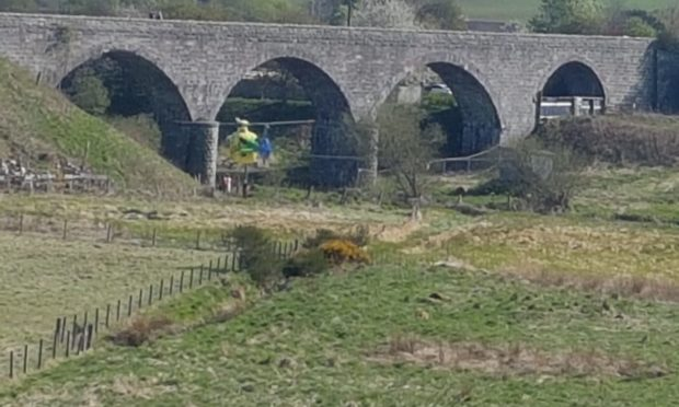 Scotland's Charity Air Ambulance was seen under the Ellon Viaduct this afternoon.