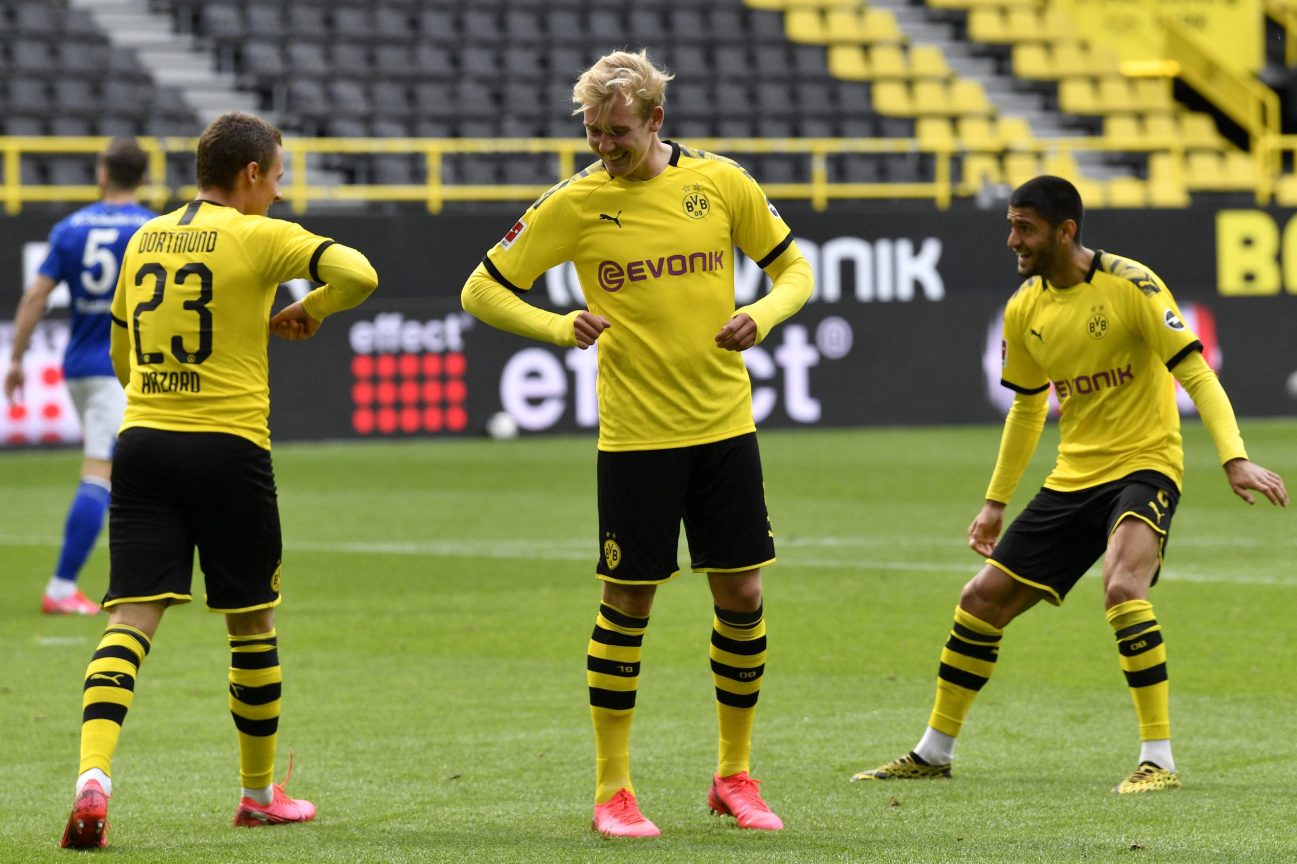 Dortmund's Thorgan Hazard, left, celebrates with Erling Haaland after scoring his side's third goal during the German Bundesliga soccer match between Borussia Dortmund and Schalke 04 in Dortmund, Germany.