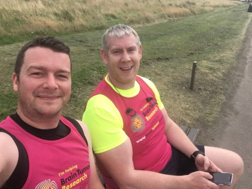 Lawyers Steven Allan and David Low have dawned their running shoes in a bid to find a brain tumour cure