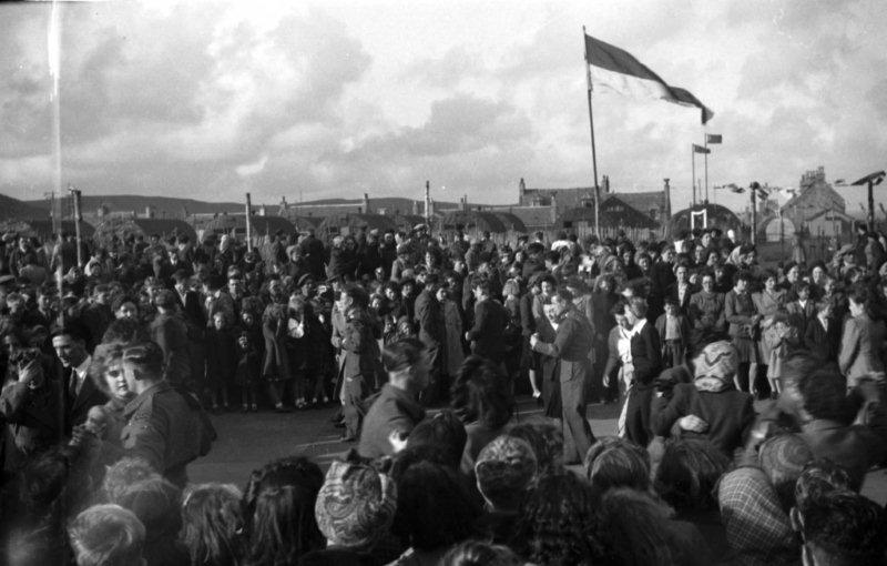 The crowds gatheed in Shetland to celebrate VE Day. Copyright: Shetland Museum/A Isbister