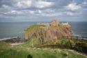 Two men were climbing dangerous cliffs around Dunnottar Castle