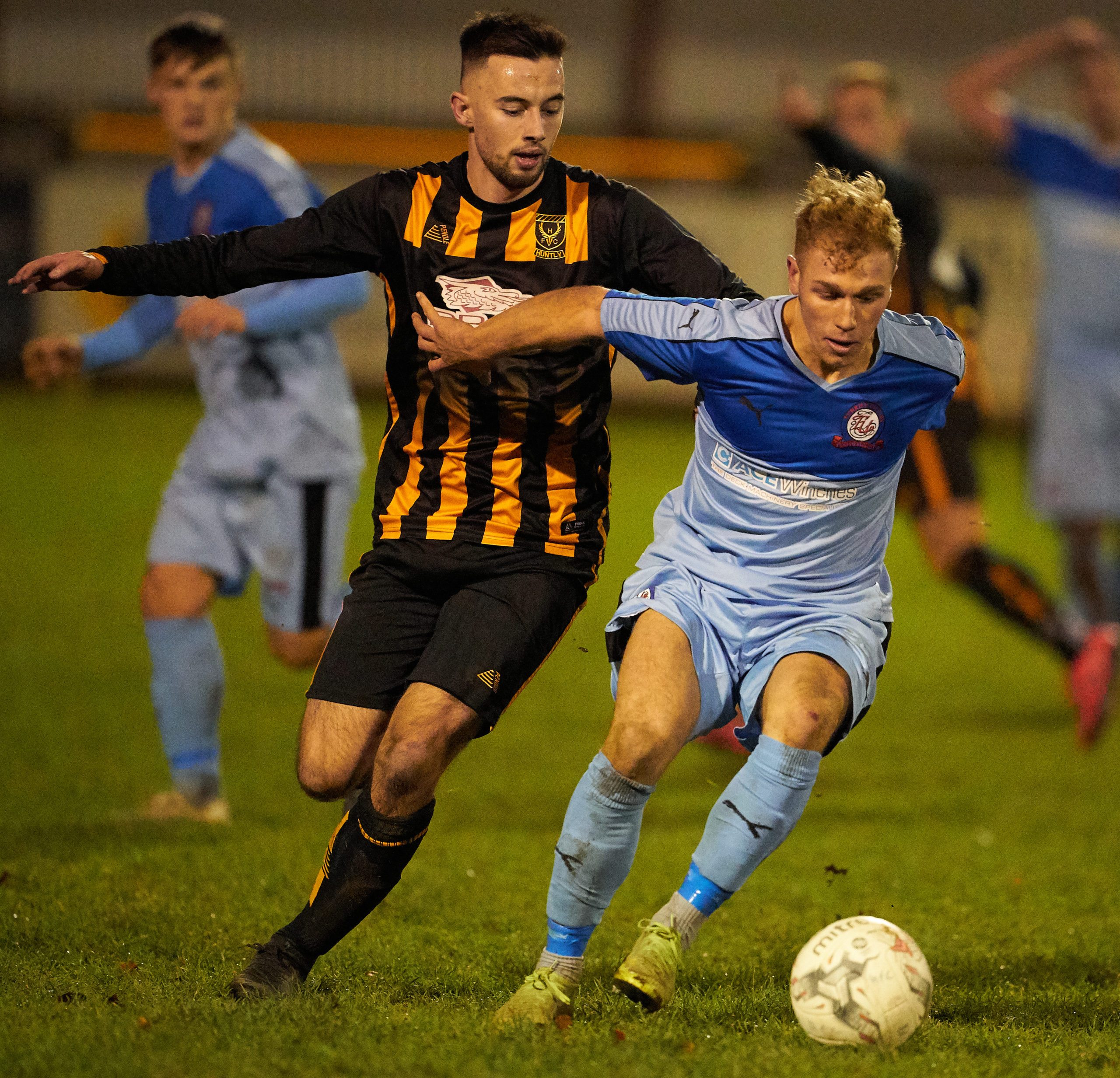 Liam MacDonald, left, in action for Huntly